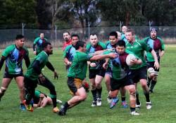 Devonport Bulls skipper Shaun Puke attempts to halt Harlequins Fale Atileo at Rugby Park in Hobart on Saturday