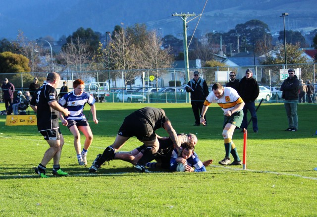 Taroona's Mikey Whyte beats the Glenorchy defence to score at Eady Street, Glenorchy.