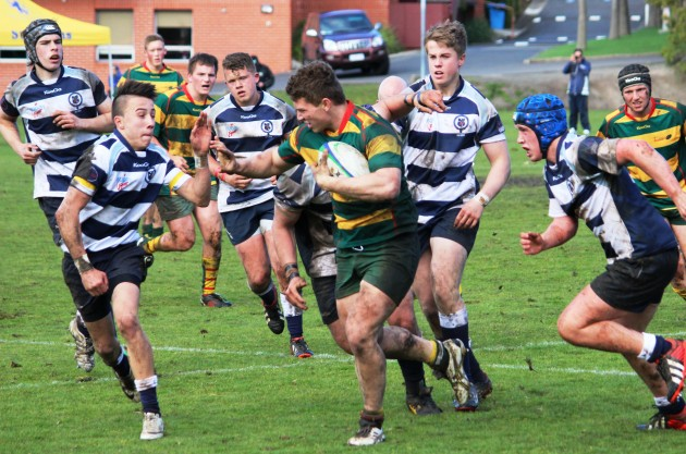 Launceston prop Jack Briggs leads the Tasmanian Under 18 attack against Victorian Schools