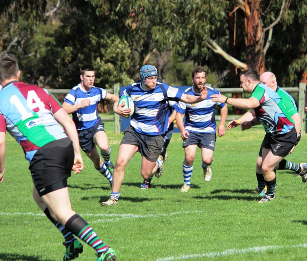 Taroona blindside flank Chris Thompson trying to work his way around Quins flanker Pat Schramm