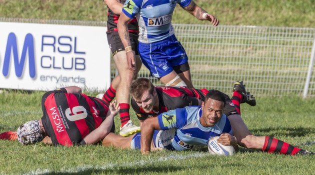 Parramatta centre Tui Faasisila leaves a trail of defenders as he scores a try_photo by Pat Dunne