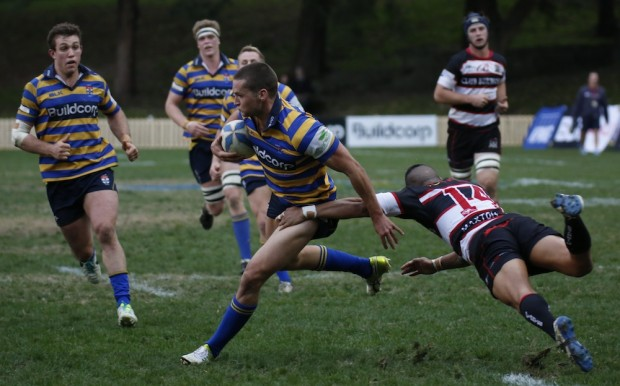 Chris Ingate clears the last hurdle in a run to the try line