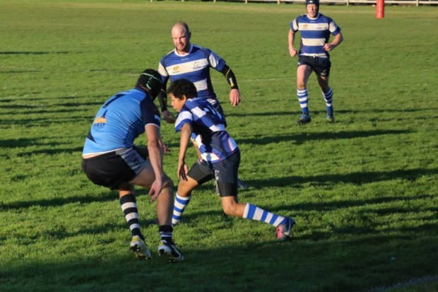 Taroona's Leroy Hart attempts to sidestep through the AMC defence - Photo Credit CMW Photography