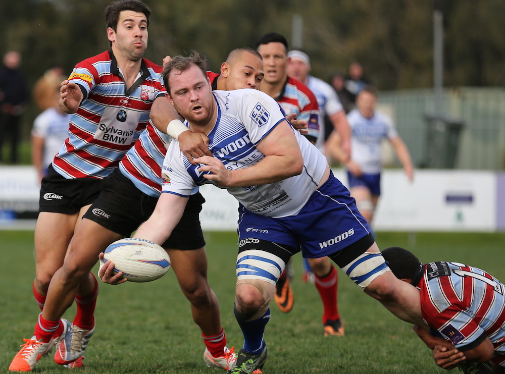 Jared Barry offloads in the tackle_PL6 Photography