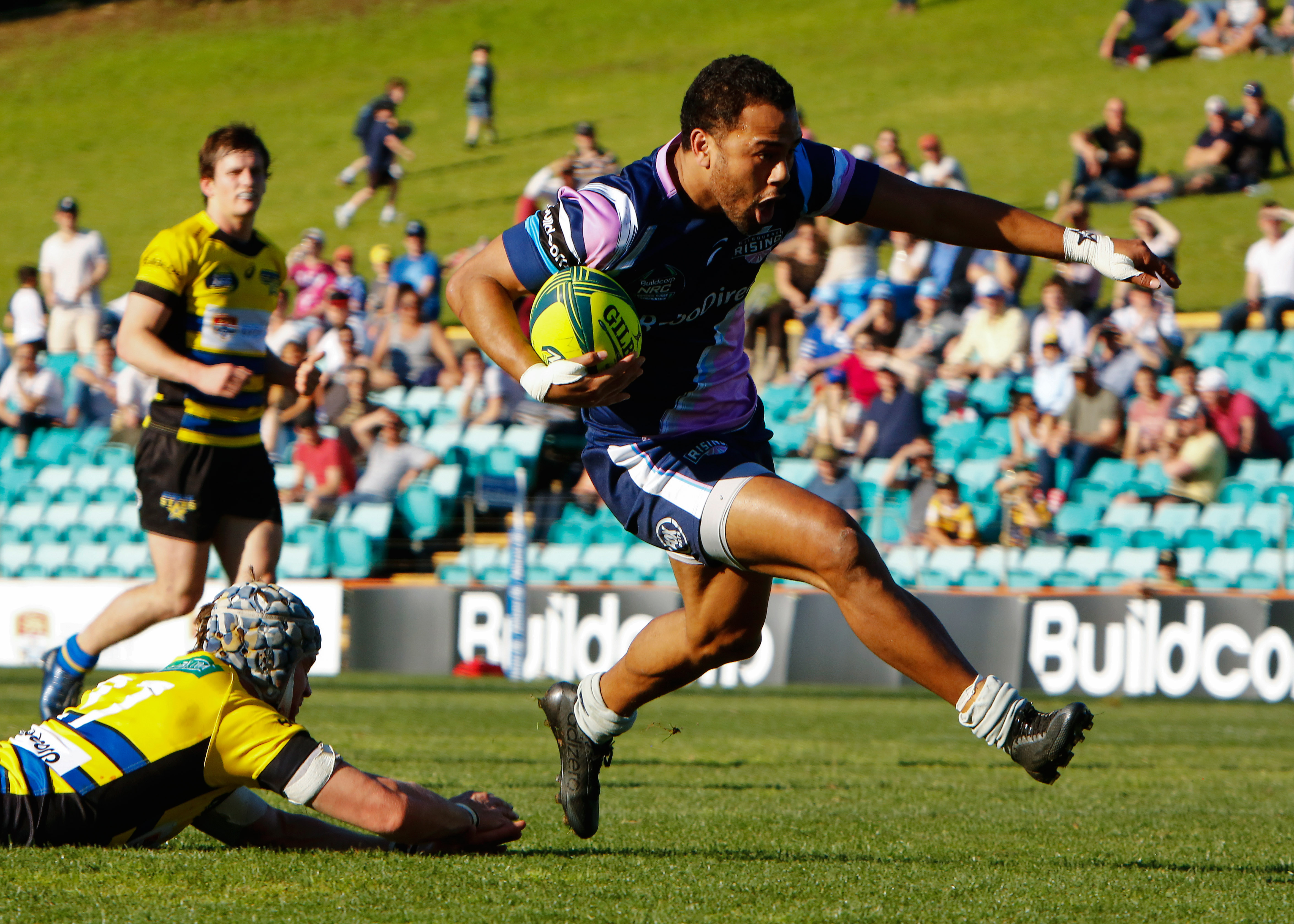 Melbourne Risings winger Talusa Veainu strides for the try line - Karen Watson Photography