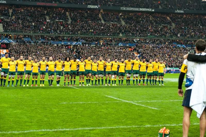 Wallabies arm in arm as teh Australian national anthem is played.