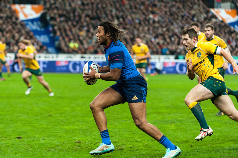 French winger Teddy Thomas runs around BernardFoley to score the second French try.