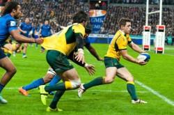 Australia's Bernard Foley passes to Adam Ashley-Cooper, who scores Australia's first try