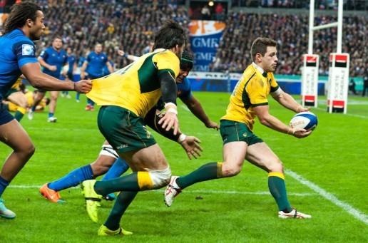 Australia's Bernard Foley passes to Adam Ashley-Cooper, who scores Australia's first try
