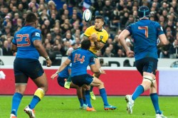 Wallabies' fullback, Israel Folau, fumbles the high ball under pressure from France's winger, Yoann Huget