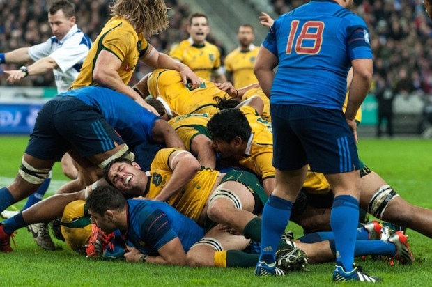 Australian lock, Rob Simmons, grimaces in pain as his team mates secure the ruck.
