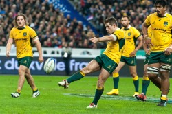 Australian flyhalf, Bernard Foley, kicking for touch following a pentaly against the French.