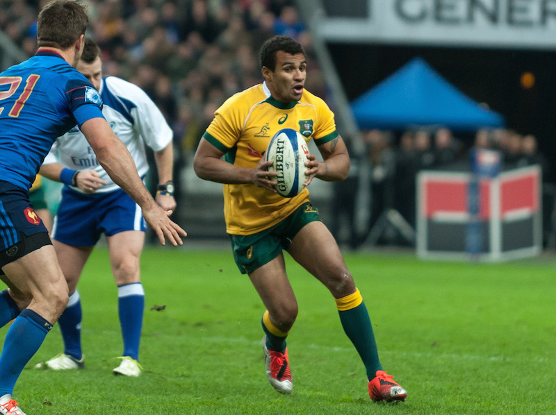 Will Genia, replacement Wallabies' half back, runs toward the line before deciding to pass.
