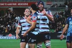 Happy Rebels Harris and Neville congratulate Debreczeni
