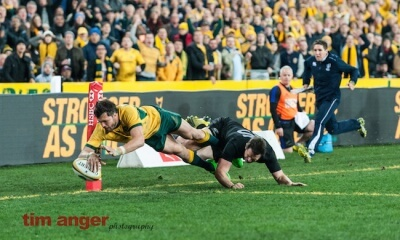 Wallabies' winger, Adam Ashley-Cooper dives for the line to score Australia's second try despite All Blacks' fullback, Ben Smith's valiant effort to stop him.