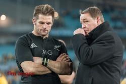 All Blacks' captain Richie McCaw and coach, Steve Hansen, share a quiet moment following the Kiwi's  defeat.