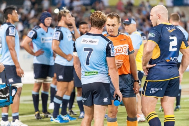 The referee talks to the captains after deciding that no sanctions were required following the all-in scuffle.
