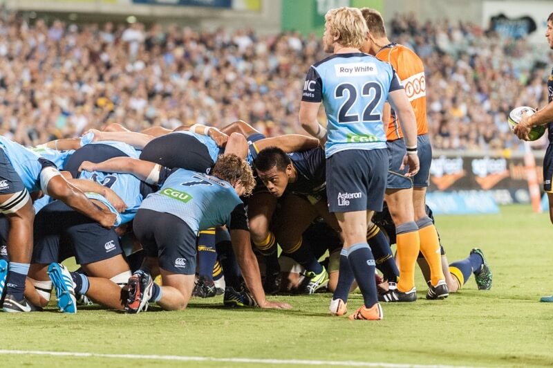Brumbies' prop Allan Alaalatoa starring out his opposite as a scrum is being packed.