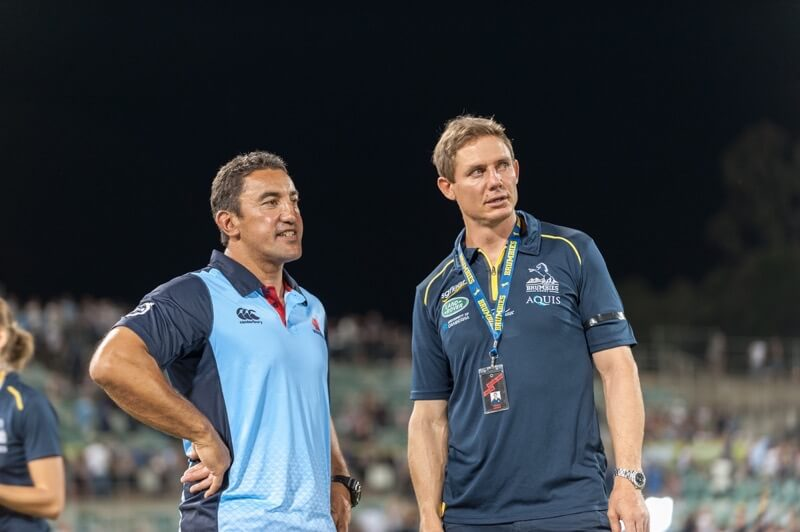 Waratahs' coach Daryl Gibson and Brumbies' coach, Steve Larkham, chat after the game.