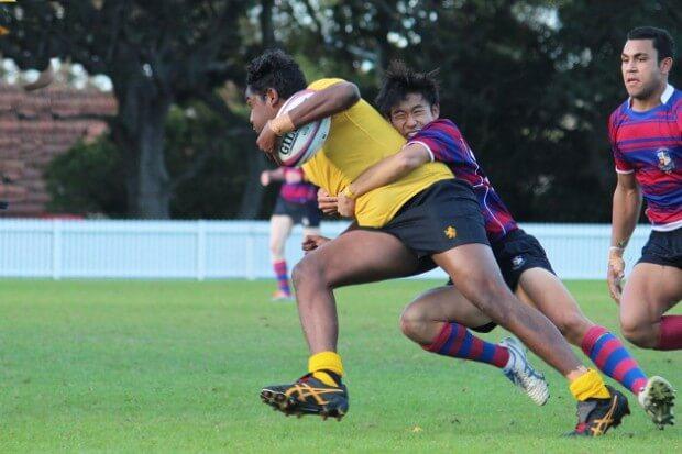 Adam Tse tackle big bopper Winston Yunupingu