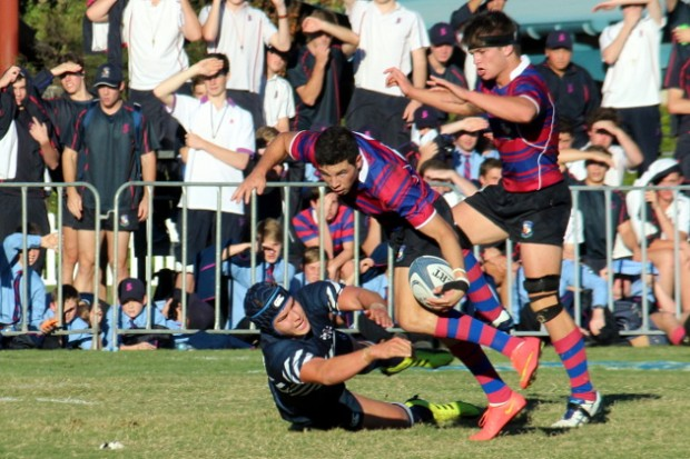 Tristan Reilly dances through a tackle