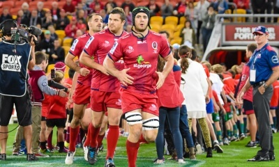 Liam Gill led out the Reds in his final game, closely followed by Greg Holmes