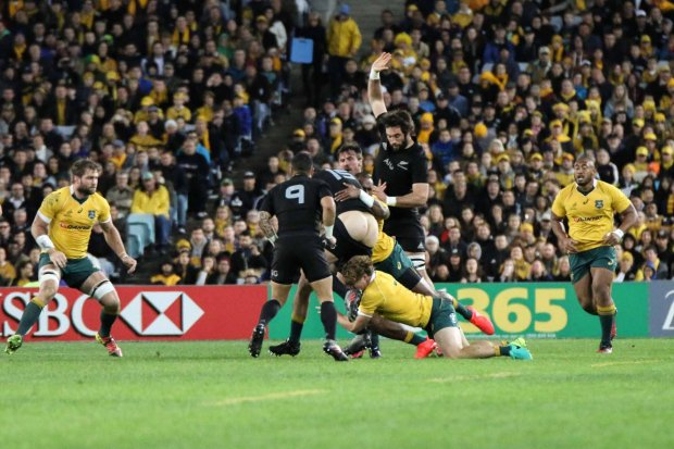 Michael Hooper gets to grips with Israel Dagg