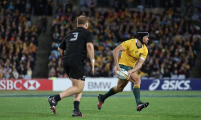 Matt Giteau shapes to pass.