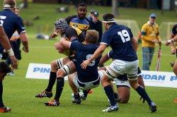 Angus Scott-Young tackles Kieran Stringer