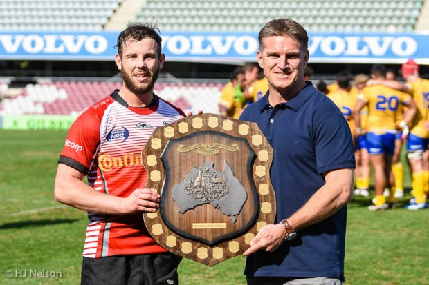 Tim Horan presents the Horan-Little Shield to UC Vikings captain Robbie Colman
