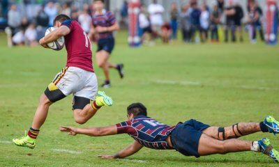BSHS winger Jared Chambers skips away from the diving tackle of Tautau Kapea