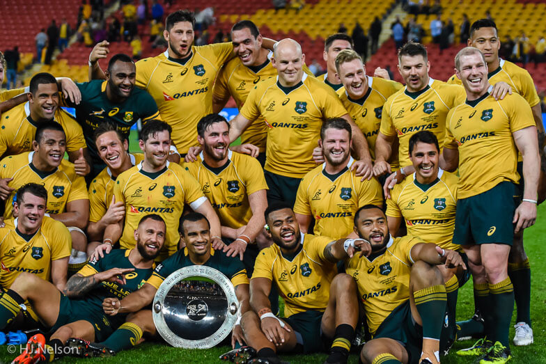 Wallabies players posing with the Nelson Mandela Challenge Plate