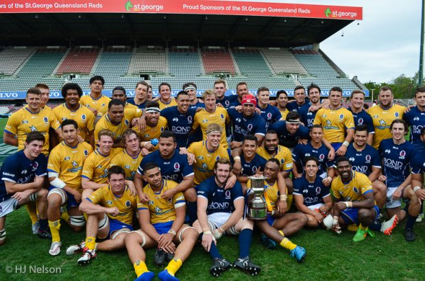 Brisbane City and Queensland Country pose for a post-match photo with the Andy Purcell Cup