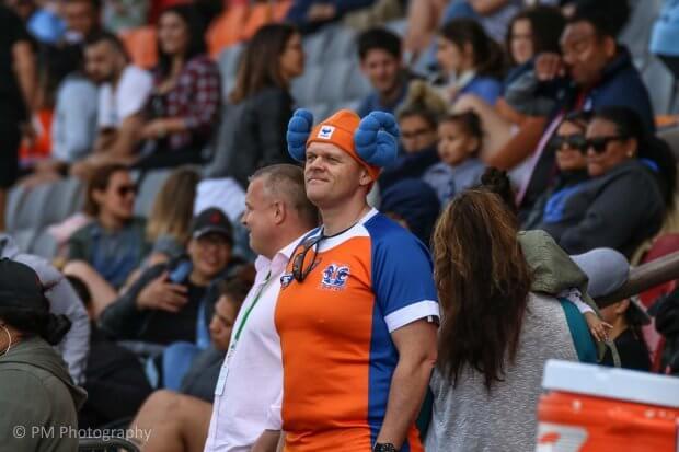 A lone fan stands in defiance.