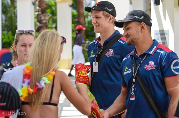 Adam Korzyk and Henry Taefu hand out Red Frogs to Gold Coast Schoolies