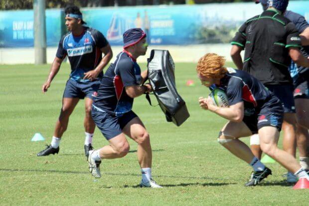 Brad Wilkin hits the tackle bag