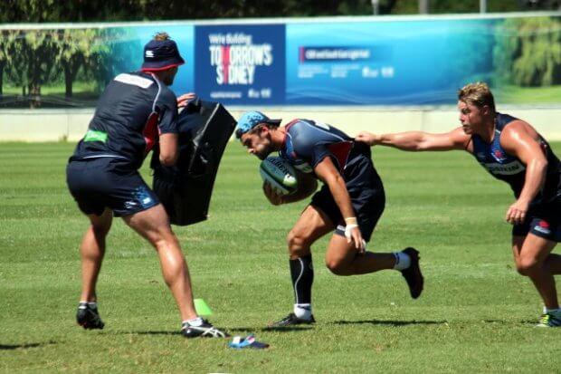 Hugh Roach latches onto Harry Jones