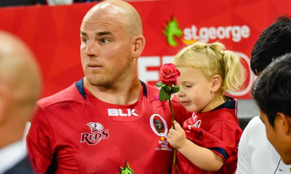 Steve Moore presents a rose on Ladies Day