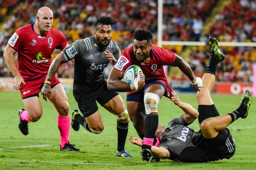 Samu Kerevi beats Digby Ioane and another Crusaders defender to score