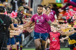 Samu Kerevi leads the REds out in their one-off retro jersey