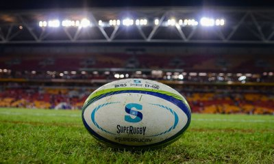 Stock Photo. Super Rugby ball plus stadium lights