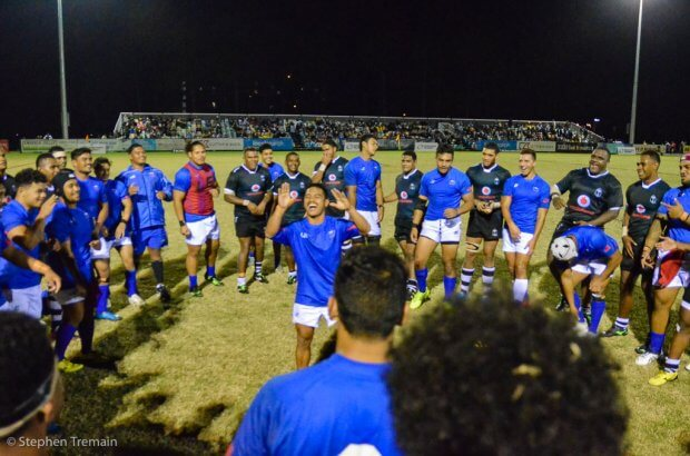 Fiji and Samoa players share a moment after their game