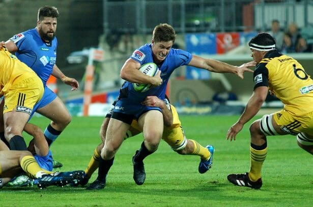 Alex Newsome tries his luck against Hurricanes' strong defence