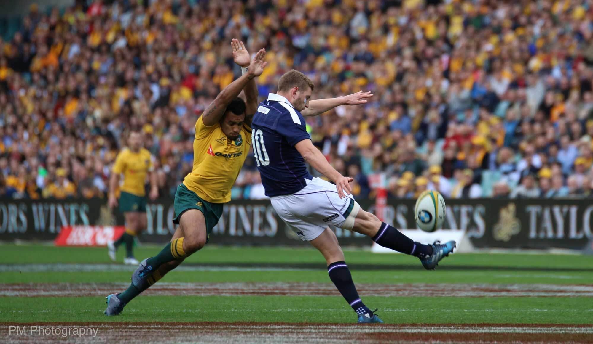 Finn Russell gets a kick off.
