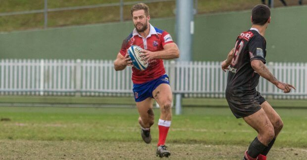 Woodhouse runs the ball against West Harbour (Image Credit - Adam MacDonald)