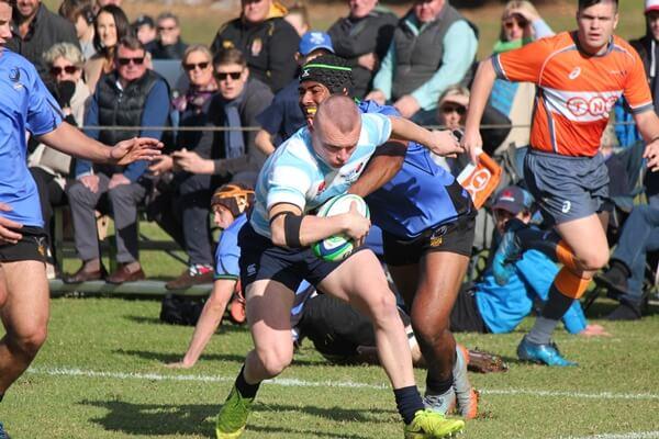 Jayden Burgess busts tackle to score Photo by Brigid Bremner