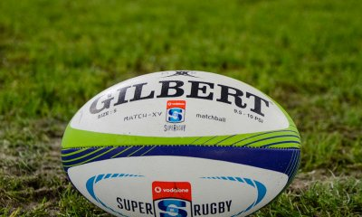Stock Photo. Gilbert Super Rugby ball on grass.