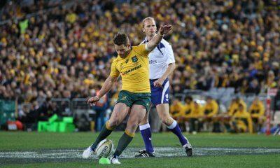 Bernard Foley kicks an early penalty, Stuart Barnes looks on.