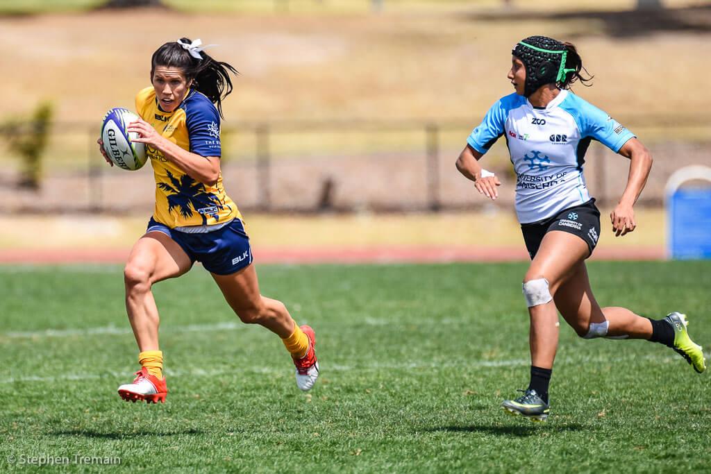 Charlotte Caslick of Bond University tries to beat Cassandra Staples of University of Canberra