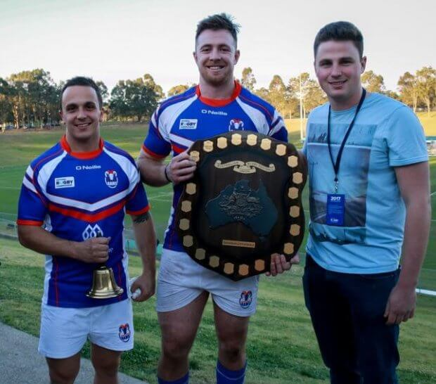 GAGR's Nick Wasiliev and Nick Hartman hand over the Horan-Little Shield and the Benn Robinson Bell over to Rams captain Jed Holloway and Jai Ayoub (Image Credit - Serge Gonzalez)